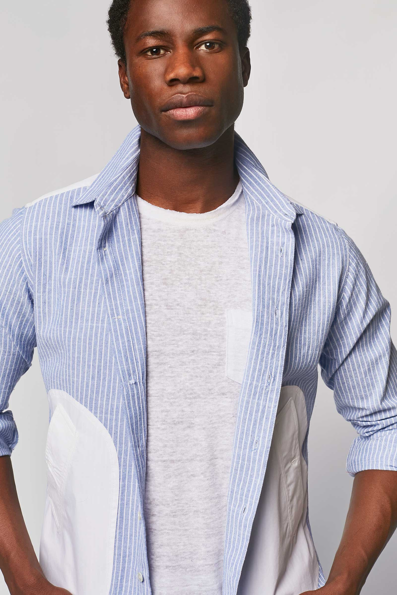 Torn blue shirt with side pockets detail