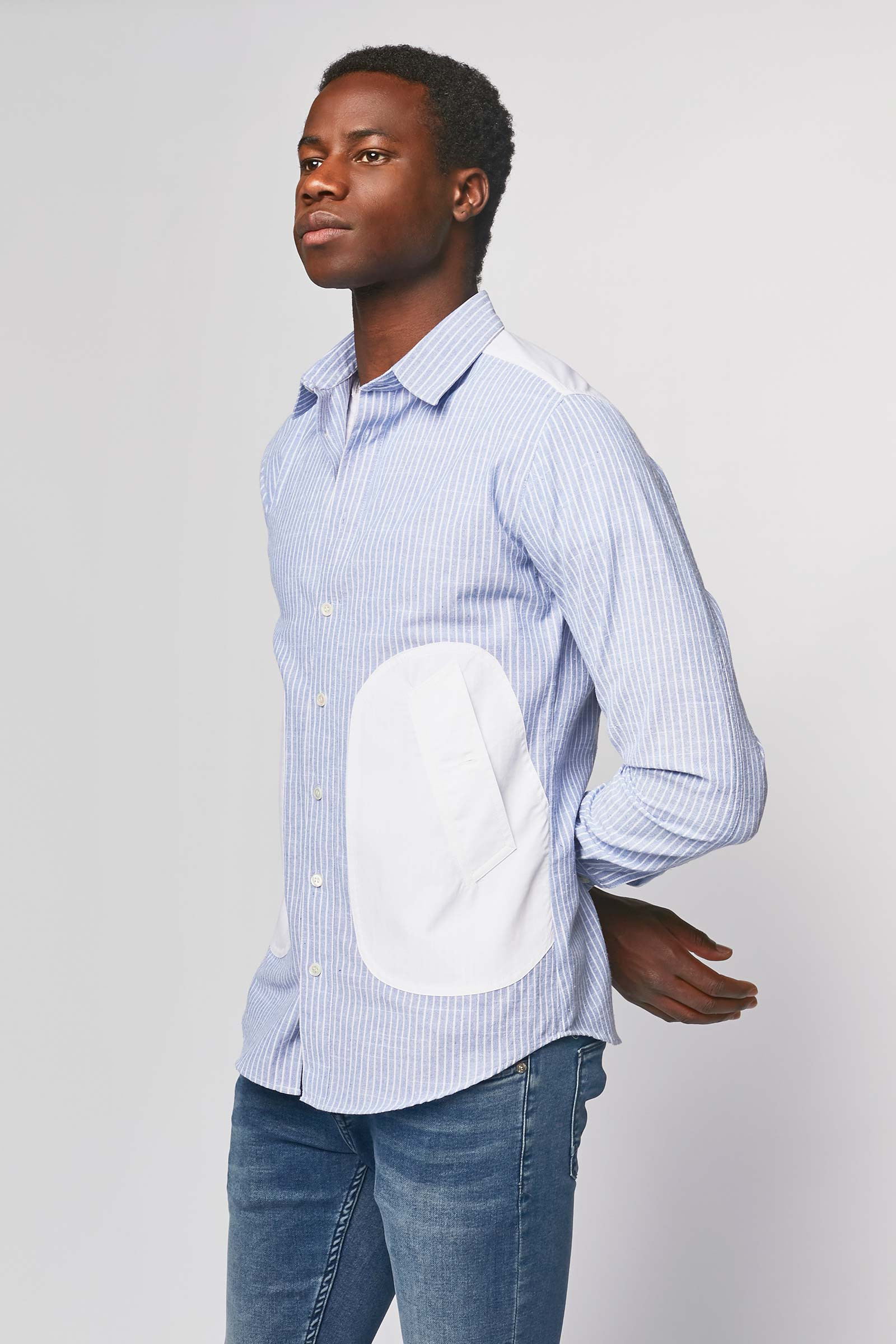 Torn blue shirt with side pockets front